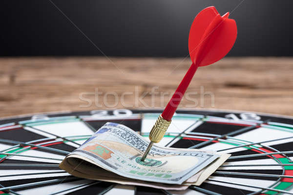 Arrow In Papernotes On Dartboard At Table Stock photo © AndreyPopov