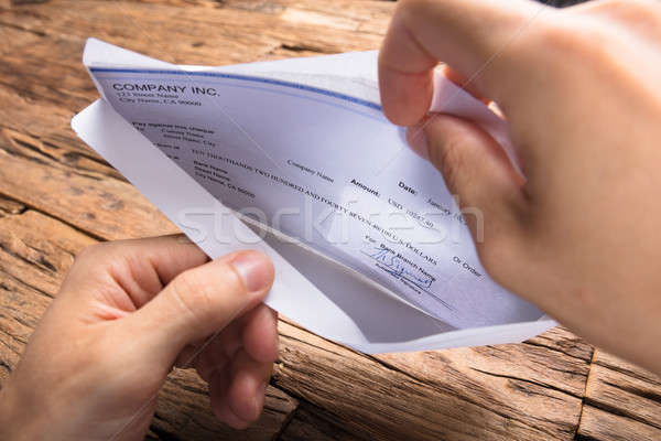 Businessman Opening Envelope With Paycheck Stock photo © AndreyPopov