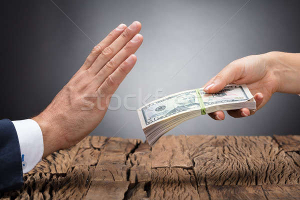 Businessperson Refusing To Take Bribe Stock photo © AndreyPopov