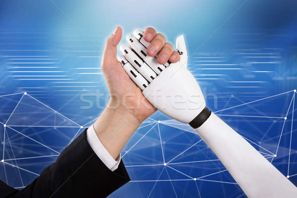 Businessman And Robot Doing Arm Wrestling Stock photo © AndreyPopov