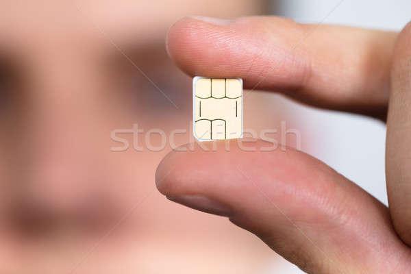 Férfi tart nano kártya közelkép telefon Stock fotó © AndreyPopov