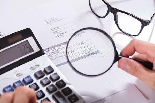 Biznesmen strony rachunek widoku lupą Zdjęcia stock © AndreyPopov