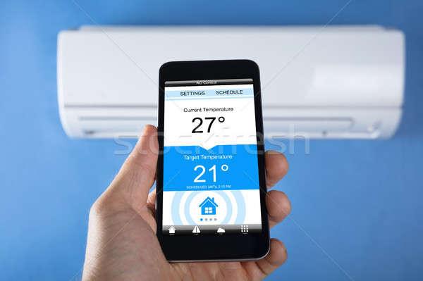 Température climatiseur personne main maison Photo stock © AndreyPopov