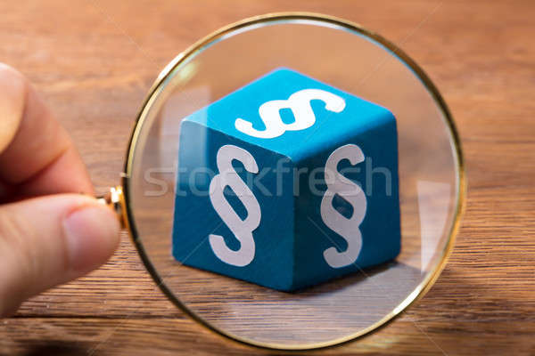Person Examining The Blue Paragraph Block With Magnifying Glass Stock photo © AndreyPopov