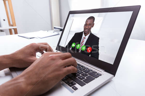 Businessperson Video Conferencing With Male Colleague On Laptop Stock photo © AndreyPopov