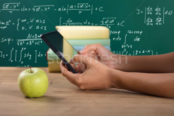 Close-up Of A Student's Hand Using Digital Tablet Stock photo © AndreyPopov