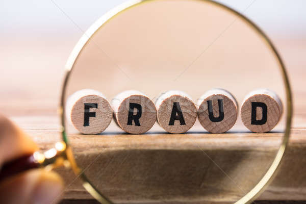Pessoa fraude blocos lupa Foto stock © AndreyPopov