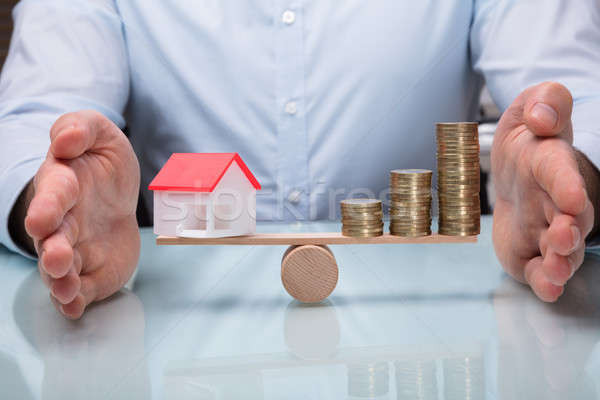 Protecting Balance Between House Model And Stacked Coins Stock photo © AndreyPopov