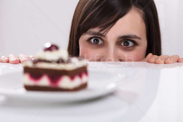 Woman Craving For Slice Of Cake Stock photo © AndreyPopov