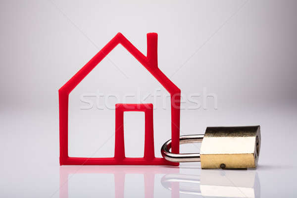 Outline Of Red House Locked With Using Keypad Lock Stock photo © AndreyPopov