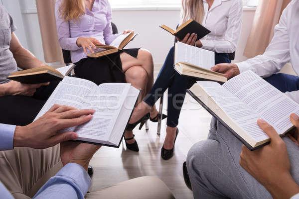 Grupy ludzi czytania święty książek posiedzenia kółko Zdjęcia stock © AndreyPopov