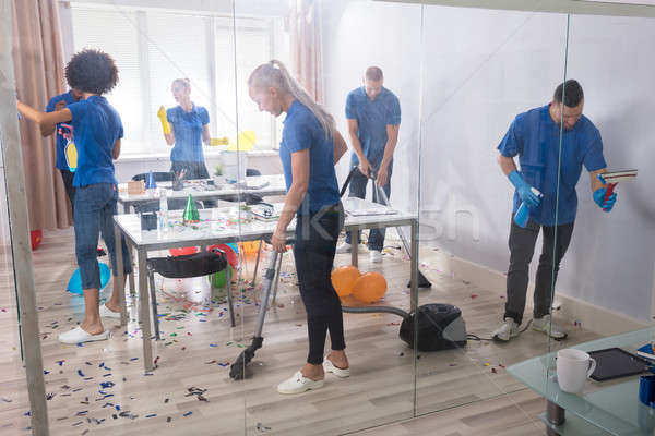 Group Of Janitors Cleaning Office Stock photo © AndreyPopov