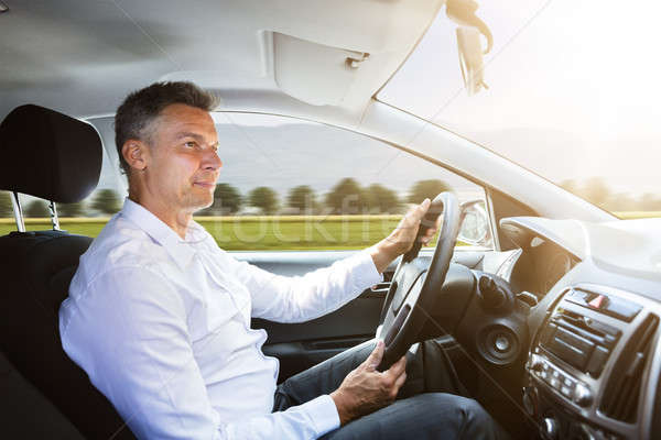 Male Driver Driving Car Stock photo © AndreyPopov