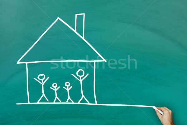Casa da família verde lousa família menina mão Foto stock © AndreyPopov