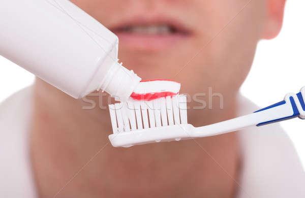 Férfi fogkefe fogkrém közelkép férfi háttér Stock fotó © AndreyPopov