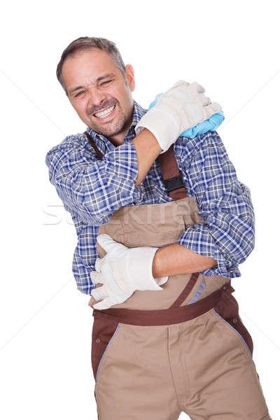Bouwvakker lijden schouderpijn witte gelukkig achtergrond Stockfoto © AndreyPopov