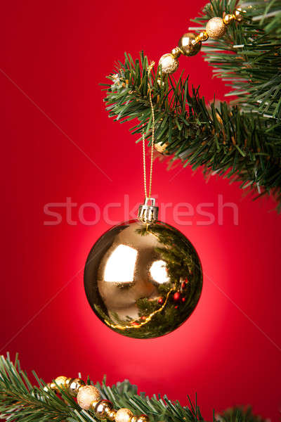 Yellow Bauble On Christmas Tree Stock photo © AndreyPopov