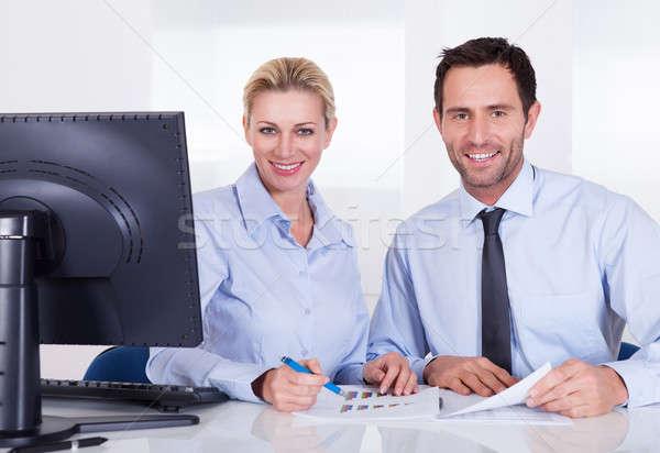 Gülen iş arkadaşları istatistik oturma Stok fotoğraf © AndreyPopov