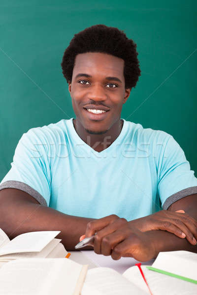 Young African Man Studying In University Stock photo © AndreyPopov