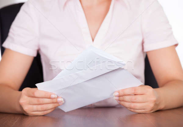 Businesswoman With White Envelope Stock photo © AndreyPopov