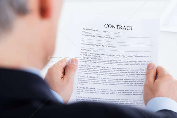 Businessman Reading The Contract Form Stock photo © AndreyPopov