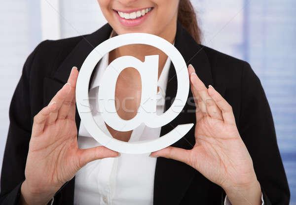 üzletasszony tart internet szimbólum fiatal iroda Stock fotó © AndreyPopov