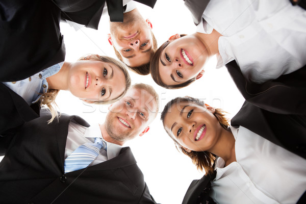 Portrait Of Business People Forming Huddle Stock photo © AndreyPopov