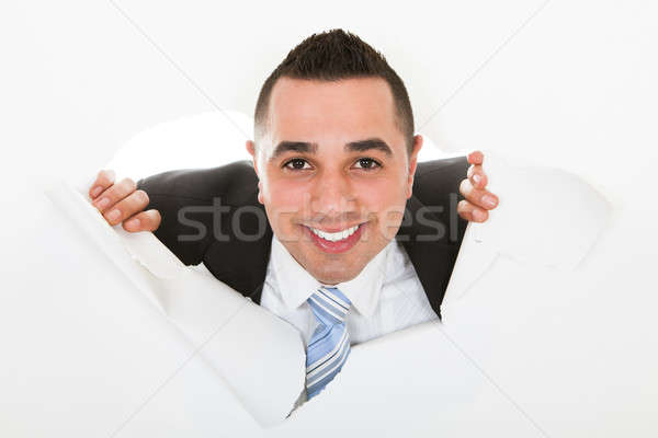 Businessman Breaking Through White Wall Stock photo © AndreyPopov