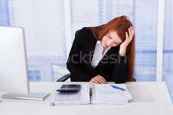 Tensed Businesswoman At Office Desk Stock photo © AndreyPopov