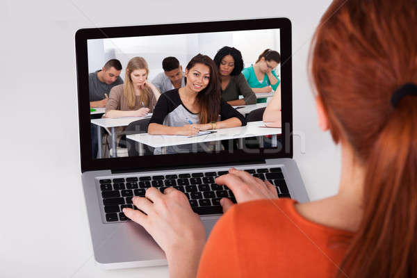 Female Student Attending Online Lecture On Laptop Stock photo © AndreyPopov