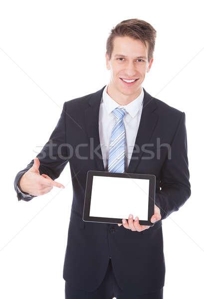 Businessman Holding Digital Tablet Stock photo © AndreyPopov