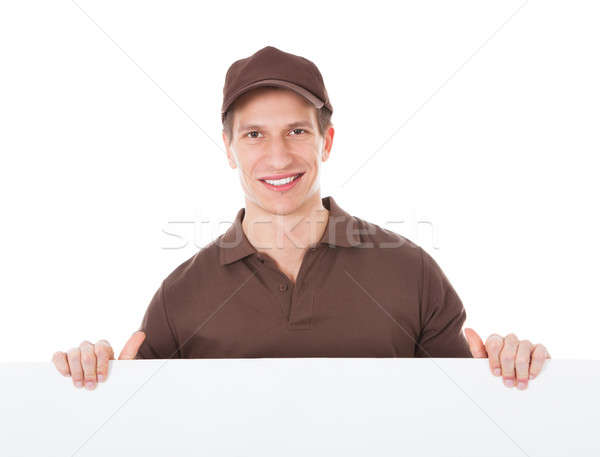 Delivery Man Holding Banner Stock photo © AndreyPopov