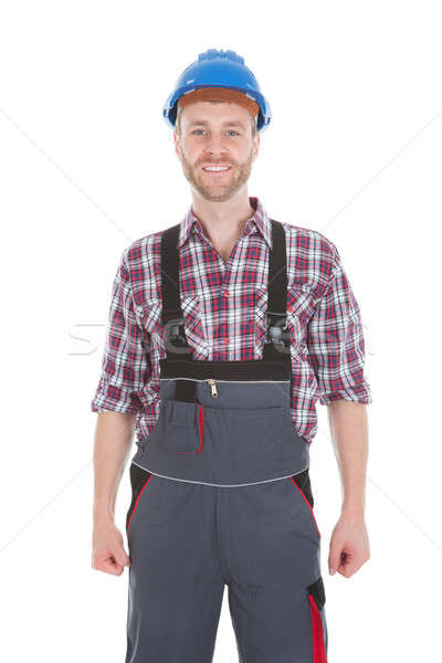 Manual Worker Standing With Hands On Hip Stock photo © AndreyPopov