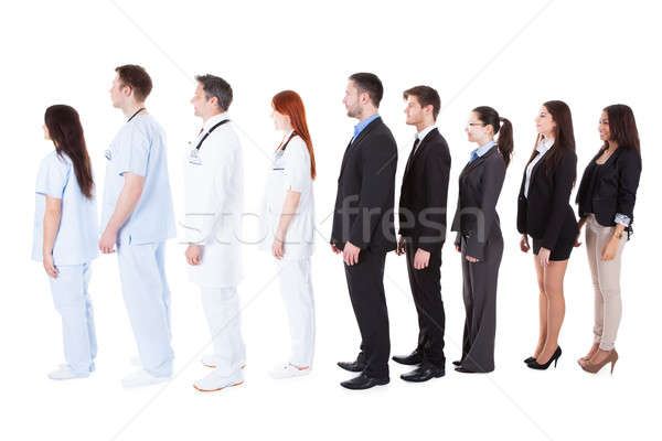 Doctors and managers standing in queue Stock photo © AndreyPopov