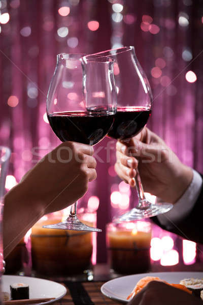 Couple Toasting Wineglasses In Restaurant Stock photo © AndreyPopov