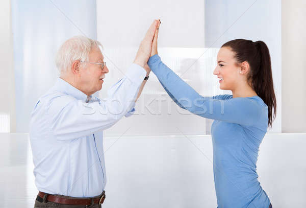 Caregiver And Senior Man Giving High Five Stock photo © AndreyPopov