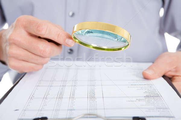Сток-фото: глядя · документа · увеличительное · стекло · бизнесмен · белый · деньги