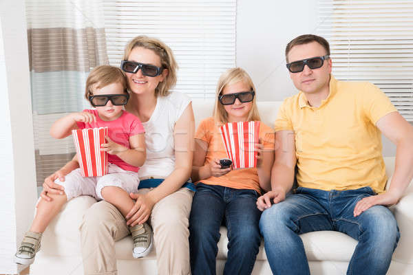 Genç aile izlerken 3D tv ev Stok fotoğraf © AndreyPopov