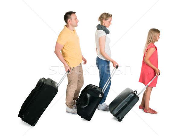 Jóvenes familia caminando equipaje aislado blanco Foto stock © AndreyPopov