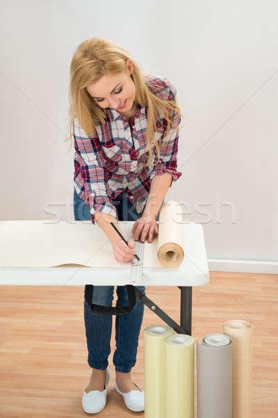 Kadın ölçüm duvar kağıdı portre genç kadın Stok fotoğraf © AndreyPopov