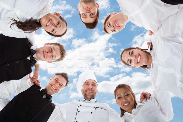 Feliz chef em pé céu diretamente abaixo Foto stock © AndreyPopov