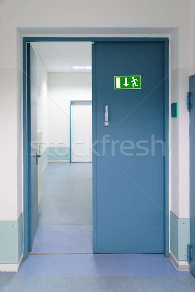 Emergency Evacuation Sign On Door Stock photo © AndreyPopov