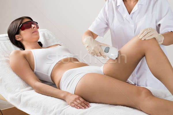 Person Giving Laser Therapy To Woman Stock photo © AndreyPopov