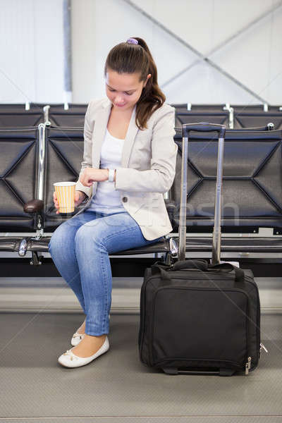 Businesswoman Checking Time At Airport Lobby Stock photo © AndreyPopov