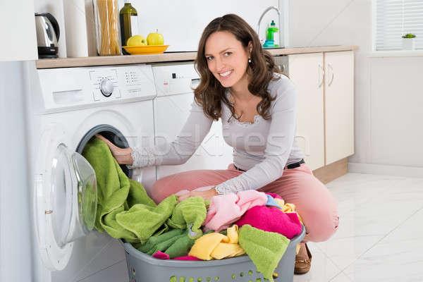 Nő ruházat mosógép fiatal nő otthon ház Stock fotó © AndreyPopov