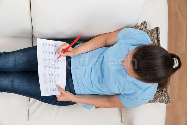 Woman Marking Date On Calendar Stock photo © AndreyPopov