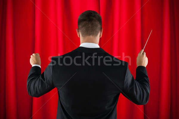 Orchestra Conductor Directing With His Baton Stock photo © AndreyPopov