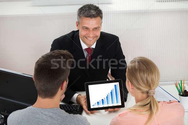 агент по продаже недвижимости графа цифровой таблетка пару Сток-фото © AndreyPopov