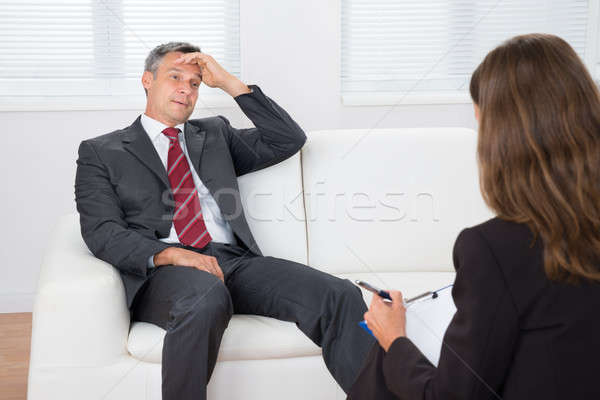 Psychiatrist Listening About Problem Of Patient Stock photo © AndreyPopov