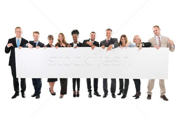 Сток-фото: счастливым · бизнес-команды · указывая · Billboard · портрет